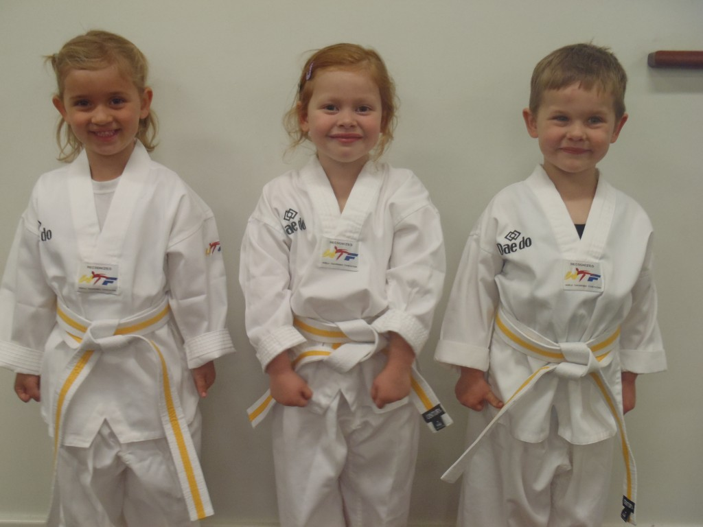 Abby Turner, Summer Marrapodi & Eric Buhlmann, proudly show the Yellow Dragonfly Belt they earned