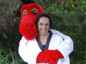 Donny The Little Dragon ( Club Mascot) Hugs Taekwondo Central Instructor Master Justin Warren