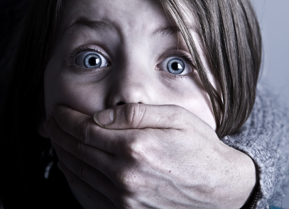 Scared Child with Hand over her Mouth