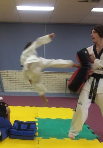 Kaiden Guiver Flying Kick - www.tkdcentral.com