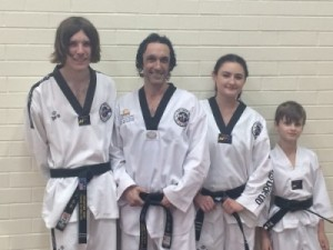 New Black Belt Promotions. John, Justin, Ajana Vanya