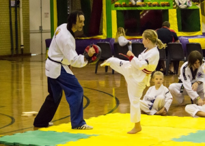 Narelle demonstartes her powerful body kick - www.tkdcentral.com