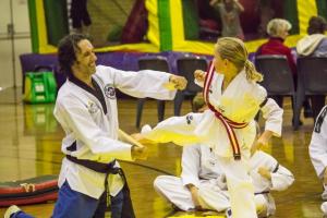 Narelle with a great side kick Board Break at Taekwondo Central Demo - www.tkdcentral.com