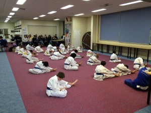 Instructor Mr John Crawford leads class in a stretch before Bunbury Junior Grading
