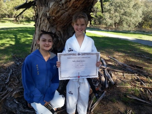 Ajana Plunkett with New Black Belt Tyler James