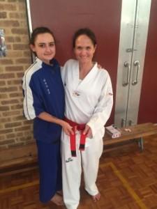 Ajana Plunkett (Head Instructor with Melanie Buhlman after grading for Probationary Black Belt. - www.tkdcentral.com