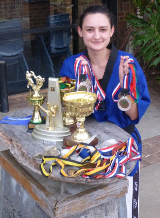 Ajana Plunkett With Her Medals - www.tkdcentral.com