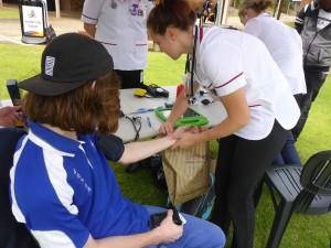 Instructor John Crawford is Health Checked By Nurse Nicola Engels - ECU Wellness Day - www.tkdcentral.com