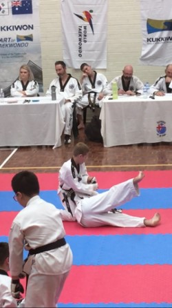 Deacon Malatesta Figuire 4 wrist locks his opponent at the Black belt Grading - www.tkdcentral,com