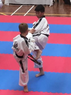 Deacon Malatesta cuts his opponenet off at the Black Belt Grading - www.tkdcentral.com