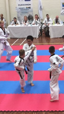 Deacon Malatesta lands his kick at the Black belt Grading - www.tkdcentral.com