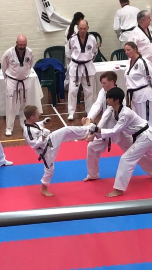 Deacon Malatesta smashes his boards during the Black belt grading - www.tkdcentral.com