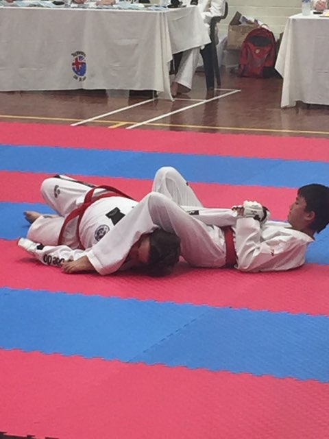 Kian Stapleton Locks A Side Arm Bar On His Partner At Black Belt Grading - www.tkdcentral.com