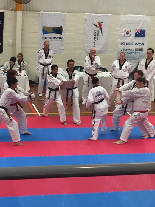 Maddison Booth About To Destroy Her boards During Black Belt Grading - www.tkdcentral.com