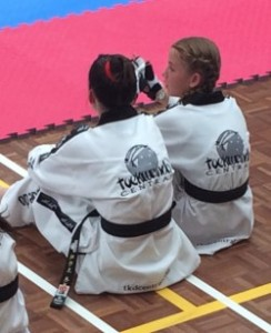 Maddison Booth & Mollie Swarbrick Await There Turn at Black Belt Grdaing - www.tkdcentral.com