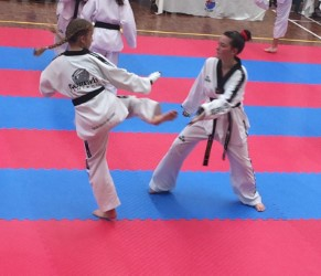 Molllie Swarbrick & Maddison Booth Sparring at the Black belt grading - www.tkdcentral.com