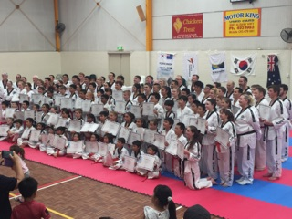 New Blackbelts Getting Teir Photo - www.tkdcentral.com