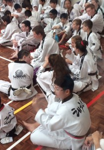 Our Black Belts Wait To Be Called At The Black Belt Grading - www.tkdcentral.com