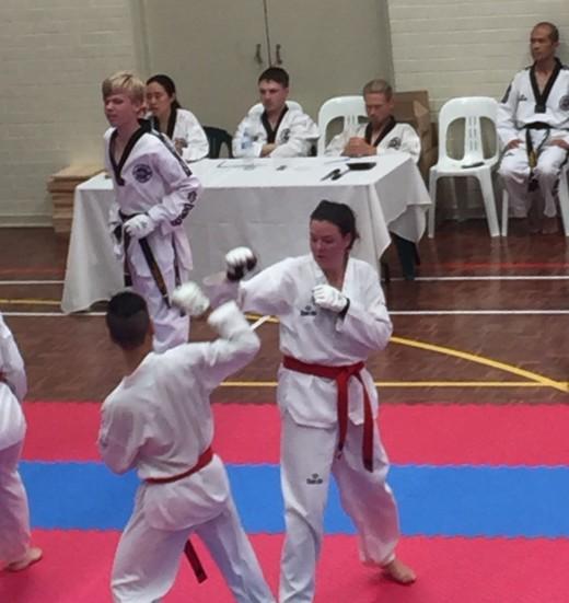 Rachel Atkinson Sparring During Grading - www.tkdcentral.com