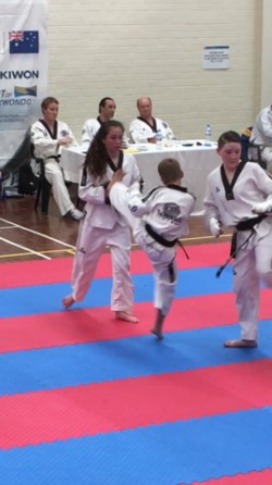 Tahlia Gowland & Deacon malatesta spar during black belt grading - www.tkdcentral.com