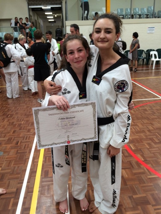 Tahlia Gowland with Ajana Plunkett after Black Belt Grading - www.tkdcentral.com