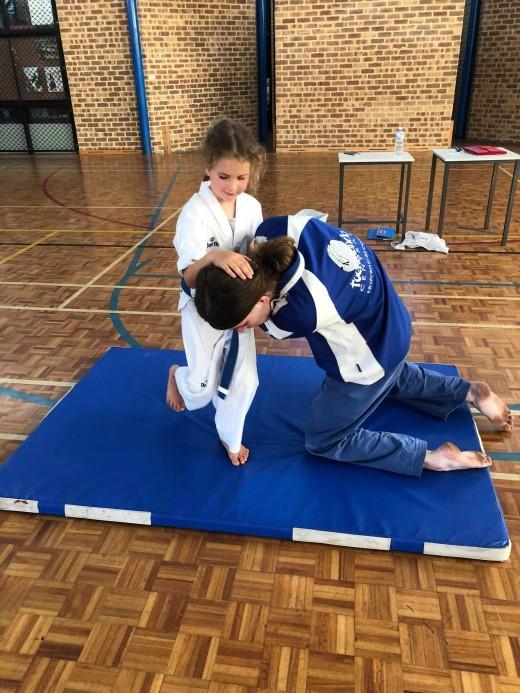 Alicia Mackay Knee Strikes Instructor John during grading
