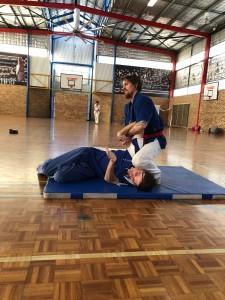 Luke Crane Wrist Locks Up Instructor John Crawford during SHP2018 Grading