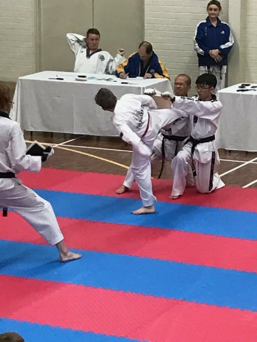 Ashton English smashes his board at Black Belt Grading - www.tkdcentral.com