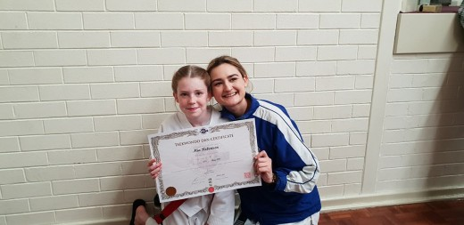 Mia Robertson with Head Instructor Ajana Plunkett - www,tkdcentral.com