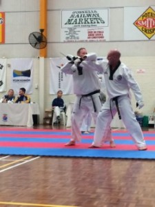 Travis Mackay performce an underarm Lock Defence against a knife attack