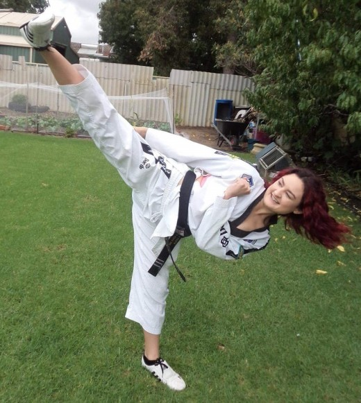 Ajana Plunkett Kicking As A 3rd Dan Blackbelt - www.tkdcentral.com