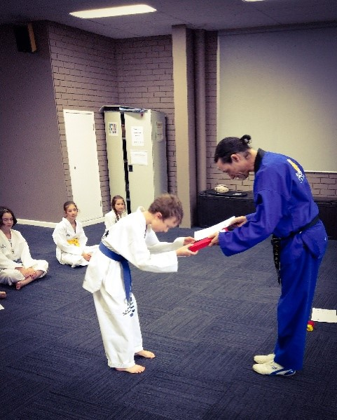 Deagan McDonald passes his Red Belt - www.tkdcentral.com