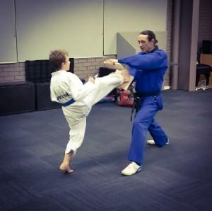 Deagan Mcdonald powers through his board break - www.tkdcentral.com