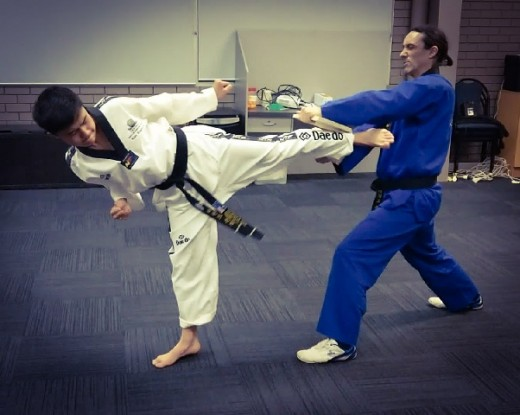 Kian Stapleton smashes the board with a back kick - www.tkdcentral.com