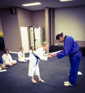 Narelle Pollard passes her red belt - www.tkdcentral.com