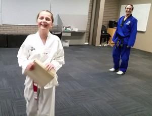 Shonna Charry with Master Justin Warren After her board break - www.tkdcentral.com