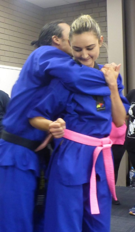 Ajana Plunkett demonstrates escaping a choke hold 1 - www.tkdcentral.com