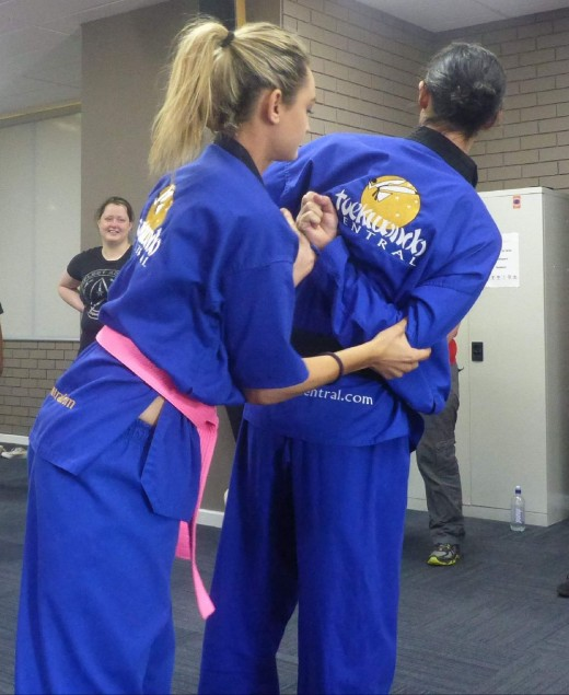 Ajana Plunkett demonstrates escaping a choke hold 2 - www.tkdcentral.com