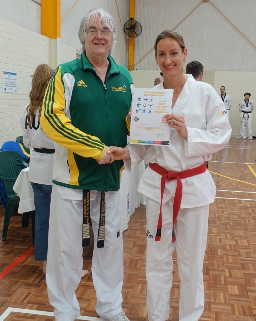 Grandmaster Ross Hartnett  Gives Kelly Rowe Her Best Black Belt Grading Award - www.tkdcentral.com