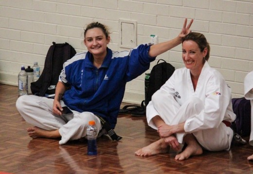 Head Instructor Ajana Plunkett Having Fun With Kelly Rowe At The 2018 Nov Black Belt Grading - www.tkdcentral.com