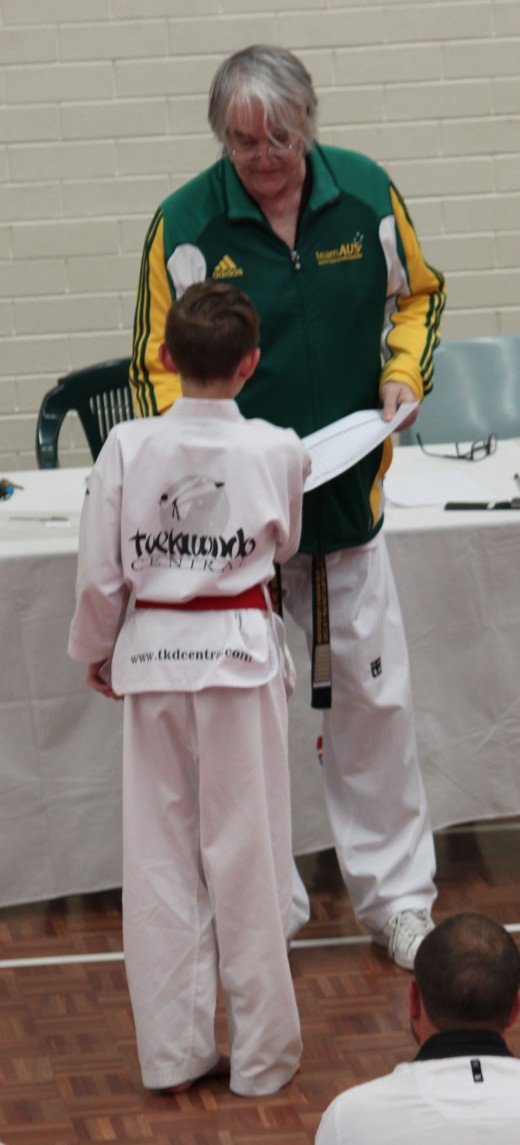 Jy Gamble Receives His Successful Black belt Result from Grandmaster Ross Hartnett - www.tkdcentral.com