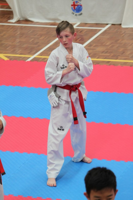 Jy Gamble on his way to a successful 1st Dan Black Belt - www.tkdcentral.com