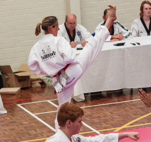Kelly Rowe Demonstrates A Hgh Front Kick At Her Black belt Grading - www.tkdcentral.com