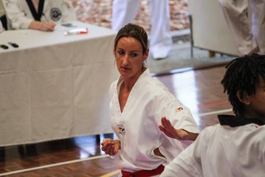 Kelly Rowe Fully Focused During The Poomsae Section Of Her Black Belt Grading - www.tkdcentral.com