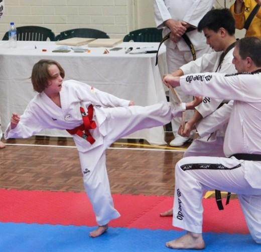 Lucas Hitchens Demonstrates A Beautiful Board Break At His 1st Dan Black Belt Grading - www.tkdcentral.com
