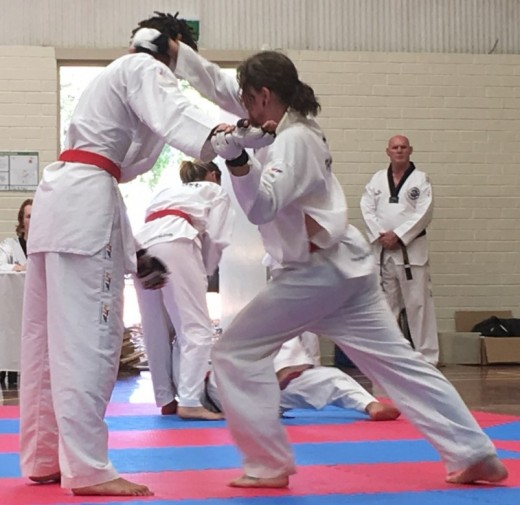 Luke Crane Knee Strikes During His Black Belt Grading - www.tkdcentral.com