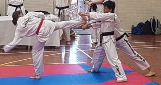 Luke Crane Smashes His Board At His Black belt Grading - www.tkdcentral.com