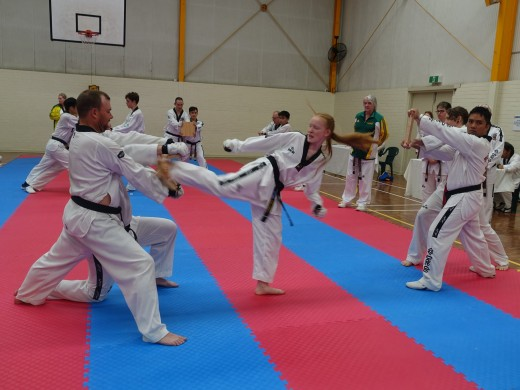 Trinity Best Smashes Her Boards On Her Way To 2nd Dan Black belt - www.tkdcentral.com