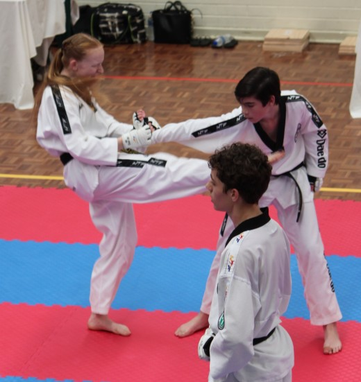 Trinity Best locks On A Straight Arm Wrist Lock Kick At Her 2nd Dan Black Belt Grading - www.tkdcentral.com